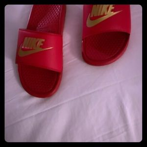 Slides by Nike.
